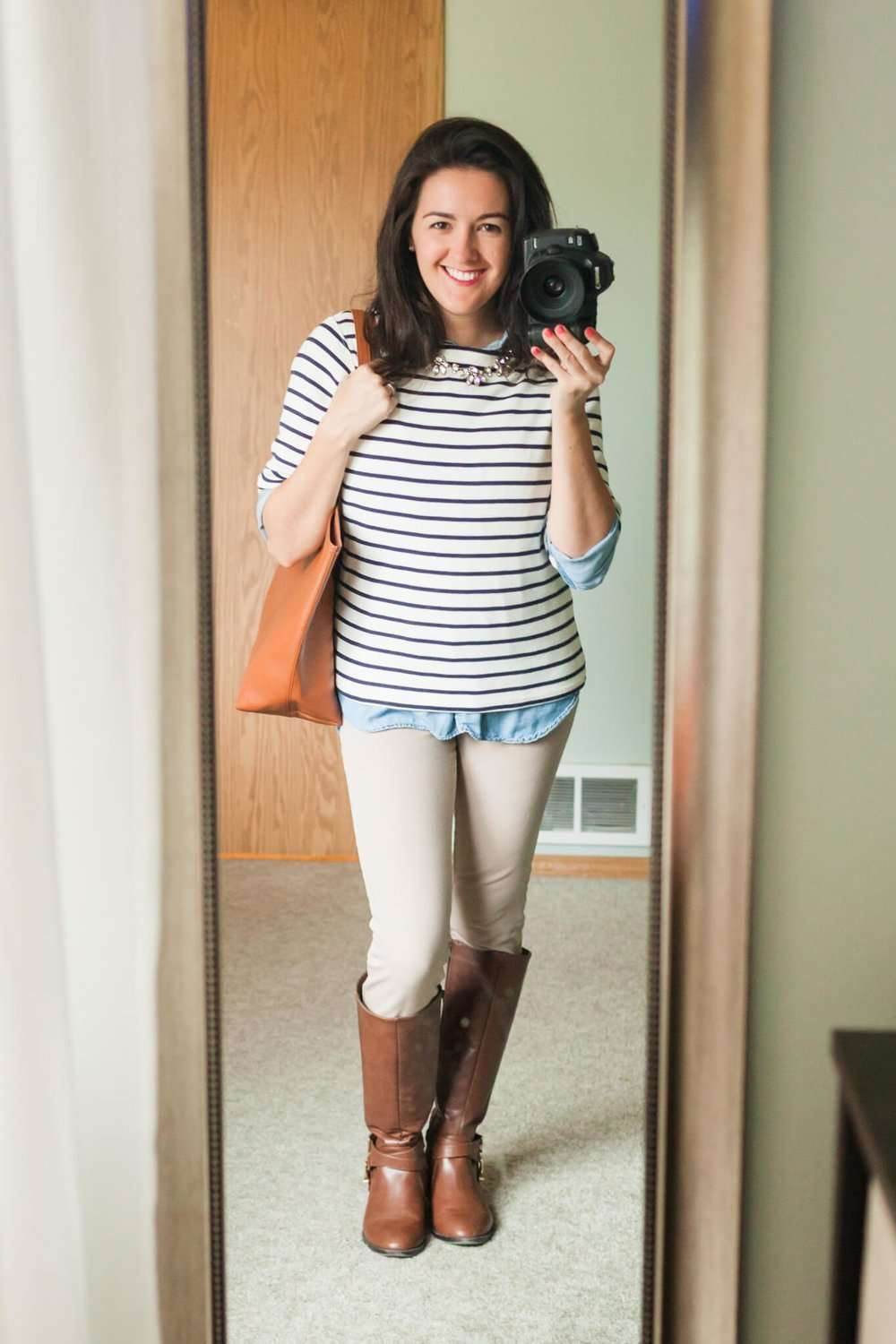 Chambray Shirt + Boat-Neck Long-Sleeve Striped Shirt + Statement Necklace + White Pants + Riding Boots