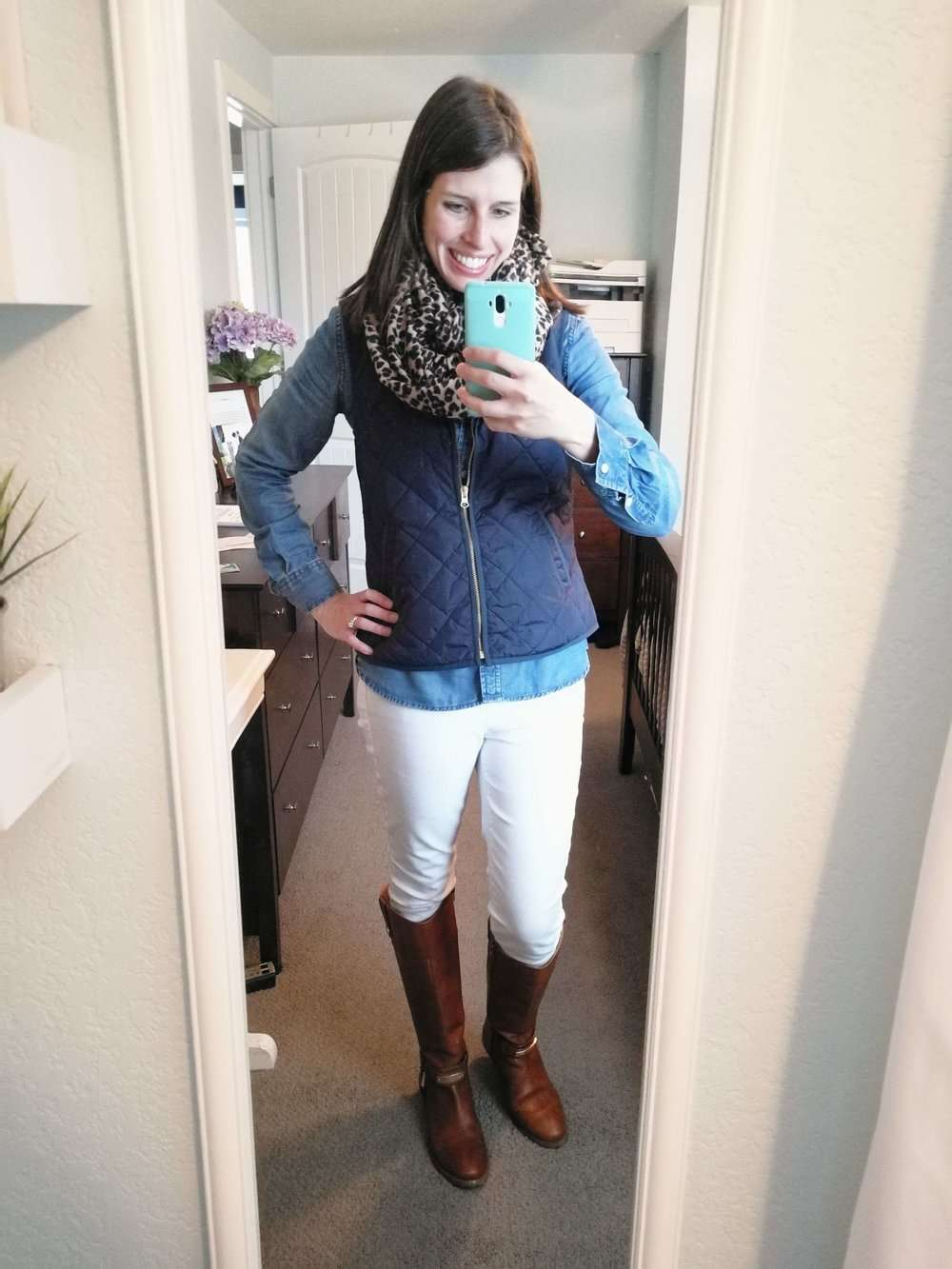 Chambray Shirt + Navy Quilted Vest + Leopard Scarf + White Jeans + Riding Boots