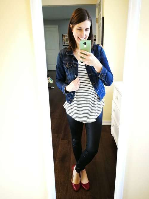 How to wear faux leather leggings. Casual chic outfit idea for winter or fall- Striped tee with round hem + denim jacket + red flats.