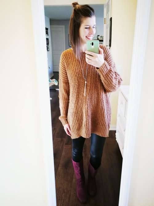 How to wear faux leather leggings. Casual outfit idea for winter or fall that covers your butt. Sweater dress + tassel necklace + boots.