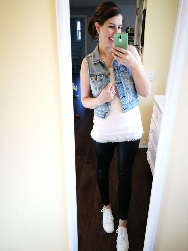 How to wear faux leather leggings in summer or spring. Casual outfit idea for moms. Sleeve less shirt (tank) + denim vest + white sneakers.